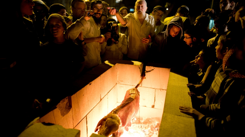Orthodox Jews from the Temple Mount Institute roast a lamb during the reenactment of the Passover sacrifice ceremony in Jerusalem (Pic: EPA)