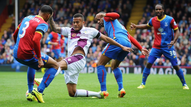 Villa's Ryan Bertrand battles for posession with Adrian Mariappa and Jason Puncheon as Cameron Jerome looks on