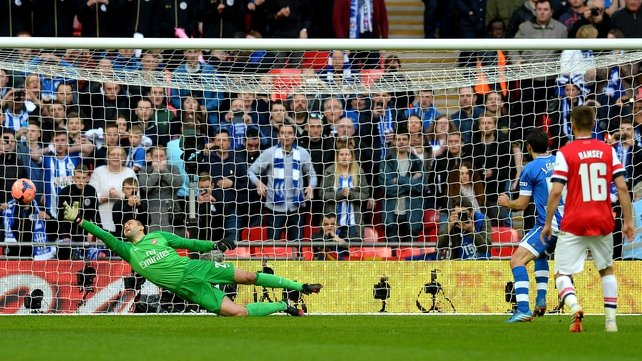 Wigan's Jordi Gomez scores the game's opening from the penalty spot