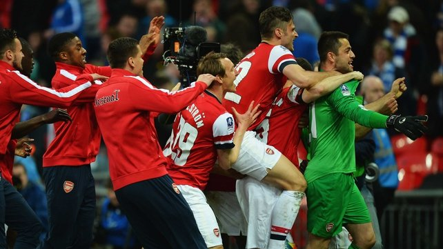 Lukasz Fabianski is mobbed at the end
