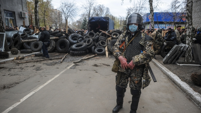 Armed men maintain their position in front of the seized police headquarters in Slaviansk (Pic: EPA)