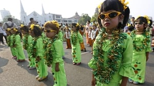 Children in Burmese traditional dresses participate in the opening ceremony of the Yangon water festival (Pic: EPA)