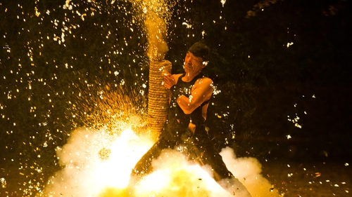 A man holds a firework housed in a bamboo tube during a ceremony in Matsudaira village, Aichi province in Japan (Pic: EPA)