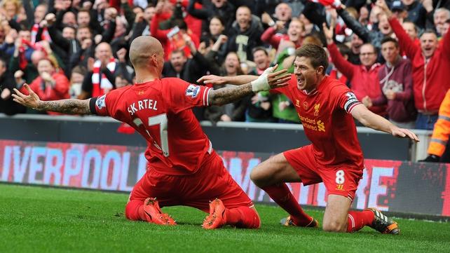 Martin Skrtel celebrates with Steven Gerrard after scoring Liverpool's second goal