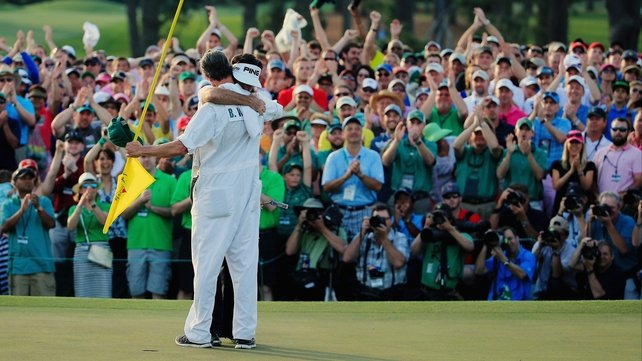 Bubba Watson celebrates the victory with his caddie