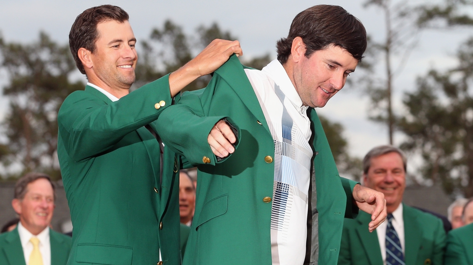 Last year's champion Adam Scott presents the Green Jacket to Bubba Watson