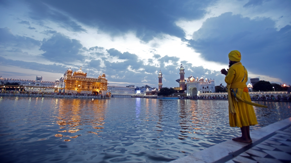 A baptised Sikh man prays at the Golden Temple, the holiest of Sikh shrines, during Visakhi festival in Amritsar, India (Pic: EPA)
