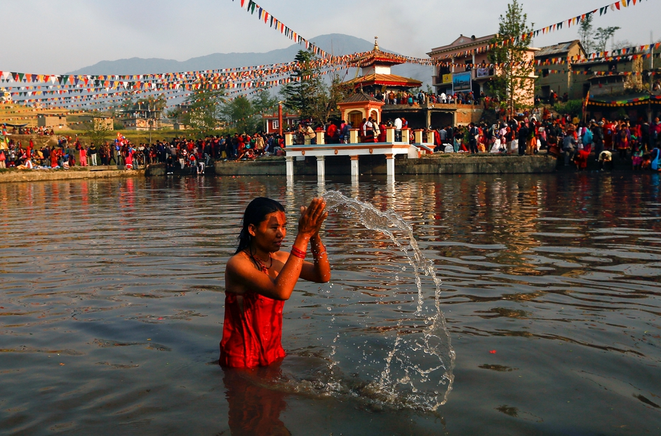 A Nepalese devotee takes a holy bath during the first day of the Nepali New Year at Sapnatirtha temple (Pic: EPA)