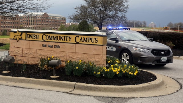 A police car blocks the entrance into the Jewish Community Campus in Overland Park, Kansas