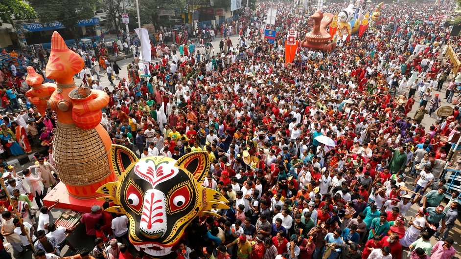 Bangladeshis attend a colorful procession to welcome in the Bengali New Year - 1421 - in Shahbagh in Dhaka, Bangladsesh (Pic: EPA)