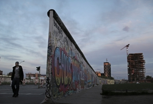 A man walks by the Berlin Wall at the East Side Gallery in Berlin (Pic: EPA)