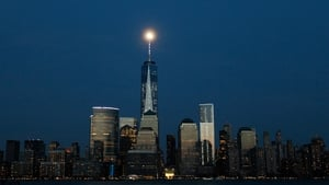 A near full moon rises behind One World Trade Center in New York City (Pic: EPA)