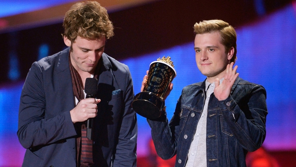 The Hunger Games: Catching Fire stars Sam Claflin and Josh Hutcherson accepting the Movie of the Year award