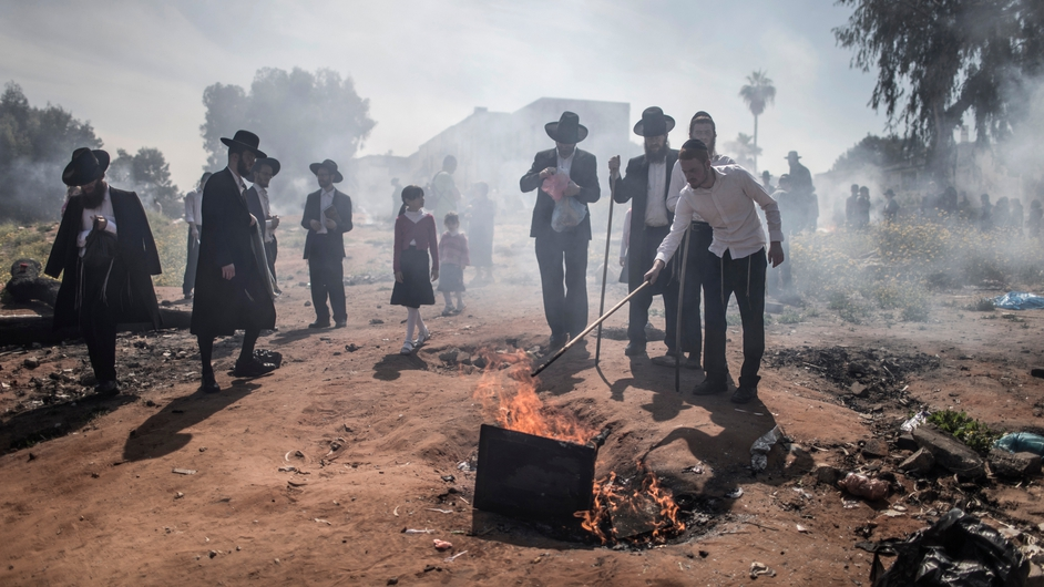 ltra-Orthodox Jewish men burn leavened products in Bnei Brak, outside Tel Aviv. The burning of all products containing leavening agents, or Chametz, is customary preparation ahead of Passover, which begins tonight (Pic: EPA)