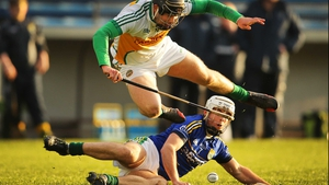 Offaly's Dan Currams and Darragh O'Connell of Kerry tussle for possession at Semple Stadium