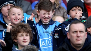 Young Dublin fans at Croke Park hope that Diarmuid Connolly can convert a penalty against Cork, he did