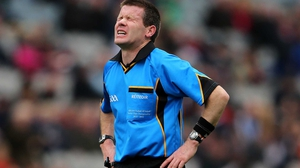 Referee Padraig Hughes feels the exertion during Derry's clash with Mayo at Croke Park