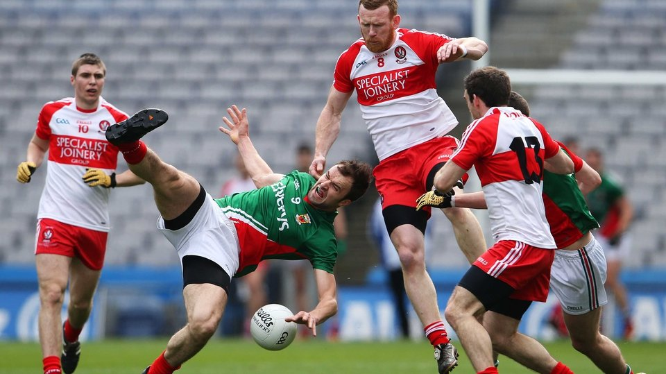 Derry's Fergal Doherty and Jason Gibbons of Mayo in action