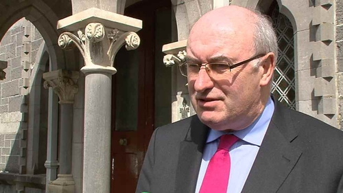 Phil Hogan said the country is obliged to meet legally-binding EU targets on reducing carbon