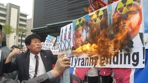 South Korean activists torch posters depicting North Korean leaders during a rally against the North Korean regime in Seoul