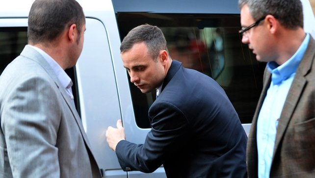 Oscar Pistorius arrives at court today for the final day of cross- examination during his murder trial