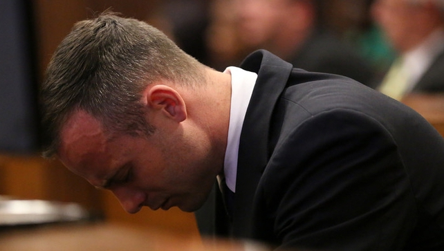 Oscar Pistorius sits in the dock during his trial at the court in Pretoria