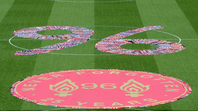 The number 96, made up of fans scarves, filled the centre circle at Anfield