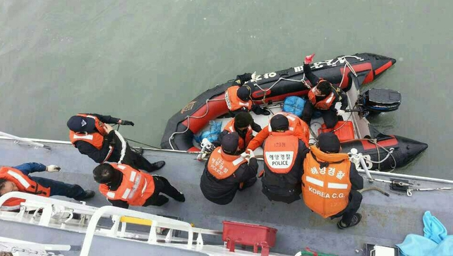 Dozens of ships and helicopters are involved in the rescue operation