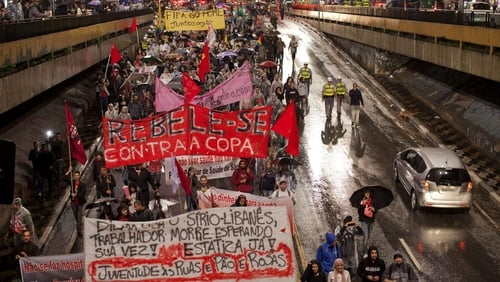 About 1,000 people marched along the key Avenida Paulista road in Sao Paulo