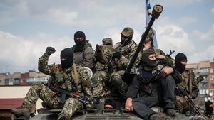 Pro-Russian supporters sit on a tank in Slaviansk, Ukraine (Pic: EPA)