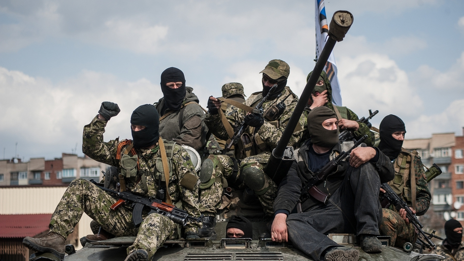 Pro-Russian supporters sit on a tank in Slaviansk, Ukraine (Pic: EPA)
