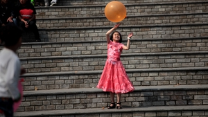 A young girl plays with a balloon on the eve of parliamentary elections in Darjeeling, India (Pic: EPA)