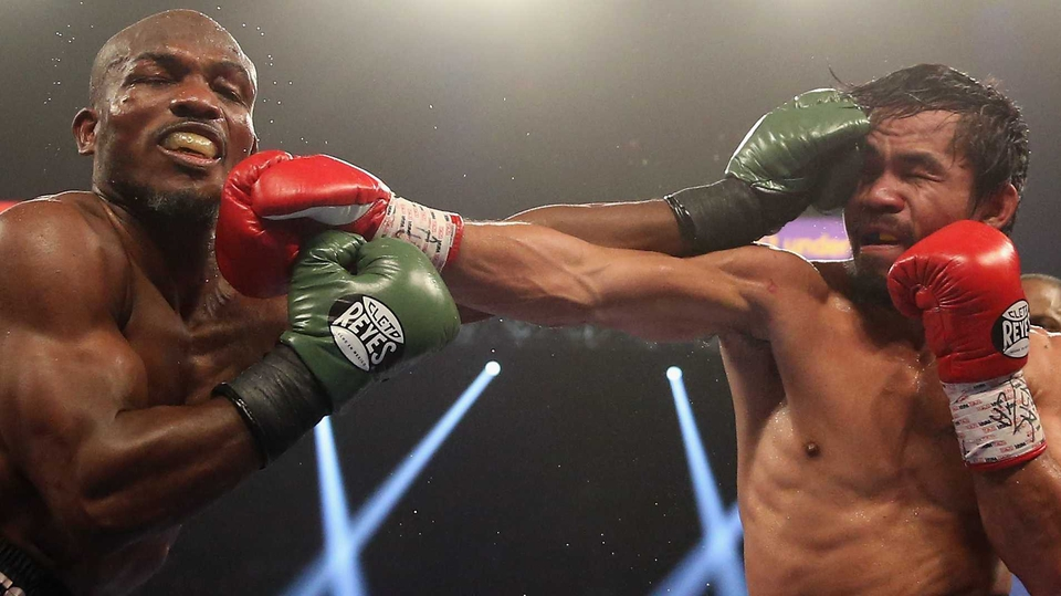 Timothy Bradley and Manny Pacquiao trade punches at the MGM Grand Garden Arena in Las Vegas