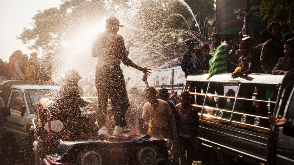Teenagers celebrate the Burmese New Year water festival, called Thingyan