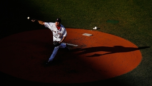 Jake Peavy pitches for the Boston Red Sox against the New York Yankees