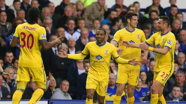 Jason Puncheon of Crystal Palace celebrates scoring the first goal with Damien Delaney, Jose Campana and Cameron Jerome