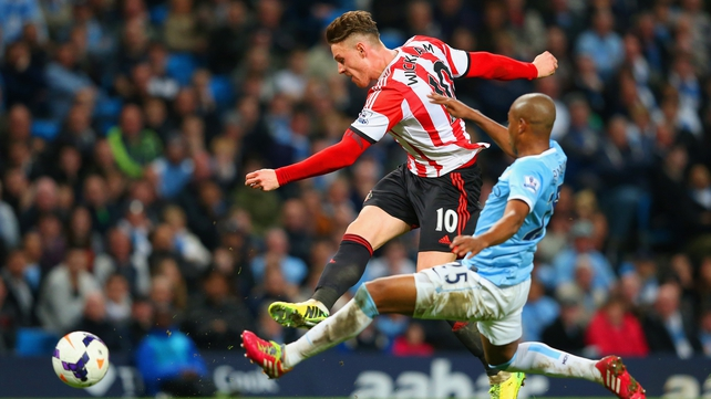 Connor Wickham of Sunderland scores their second goal under pressure from Fernandinho