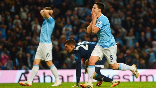 Samir Nasri (R) missed a great chance at the very end