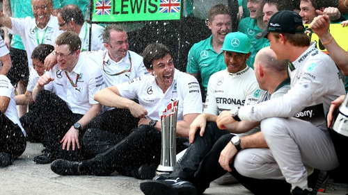 Lewis Hamilton and Nico Rosberg celebrate with Toto Wolf (centre) after victory in Malaysia