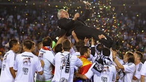 Real Madrid players celebrate their Copa Del Rey victory over Barcelona with their coach Carlo Ancelotti