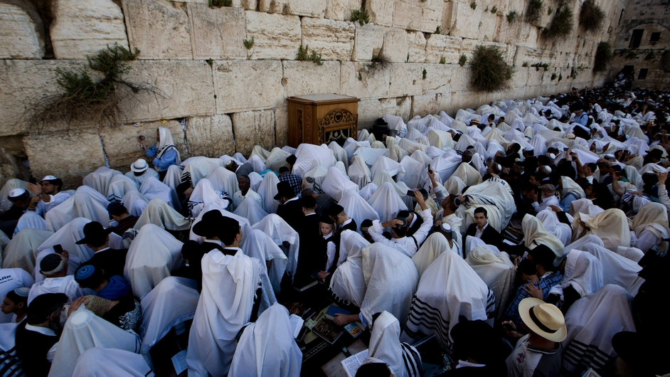 Ultra-Orthodox Jews recite the Priestly Blessing in front of the Western Wall in Jerusalem (Pic: EPA)