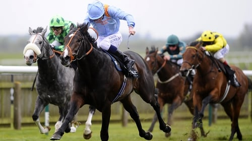 Ryan Moore riding Toormore (blue silks) go on to win the Craven