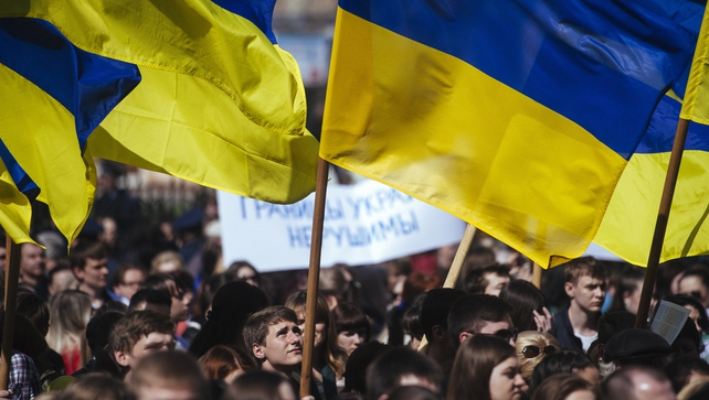 A Ukrainian student waves his national flag during a nationalist and pro-unity rally in the eastern city of Lugansk