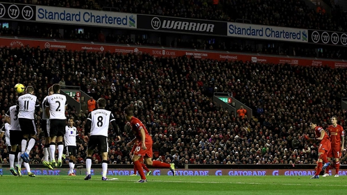 Luis Suarez scores from a free-kick against the Canaries in December