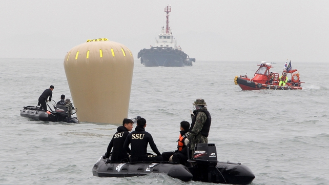 South Korean Navy's SSU members prepare to search for missing passengers off Jindo