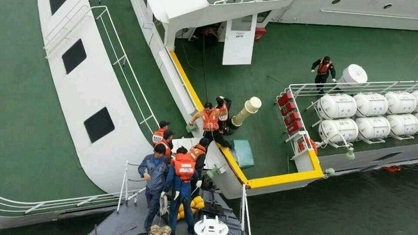 Captain Lee Jun-Seok receives help from maritime policemen to escape after the ferry sank