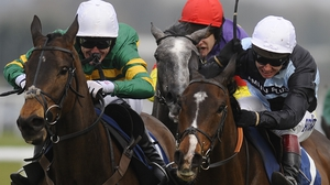Shutthefrontdoor (L) is Tony McCoy's mount in his final Aintree Grand National