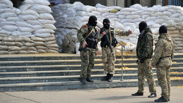 Armed men guard a regional state building seized by the separatists in the eastern Ukrainian city of Slavyansk