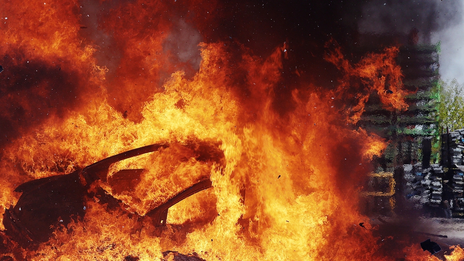 Former employees of a car manufacturer set fire to a car to denounce their dismissal conditions in central France