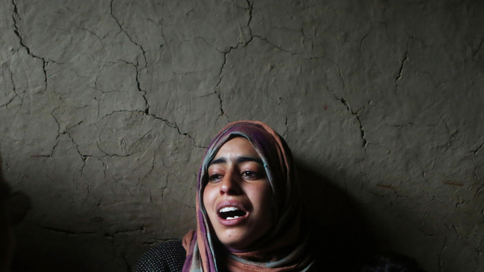 A relative mourns during a funeral in Gulzarpora village in south Kashmir